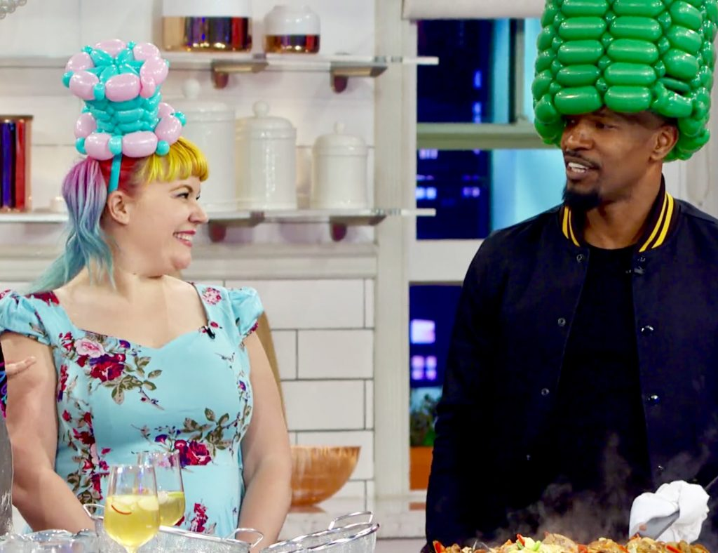 Balloon hats on Martha and Snooptawney makes google eyes at Jamie Foxx